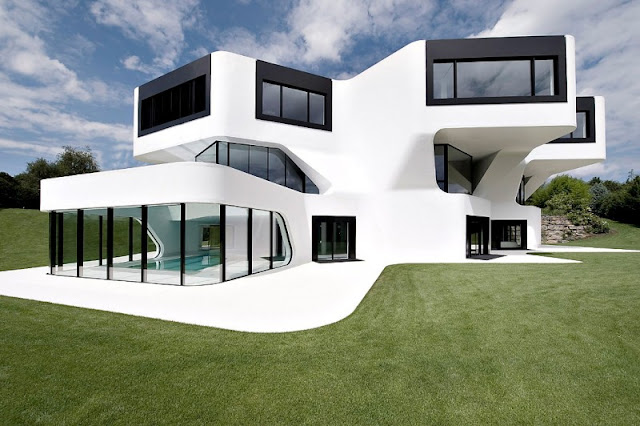 Green Grass Garden and White Colored Wall Media from Concrete