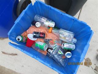 Plastic bags in blue recycling bin