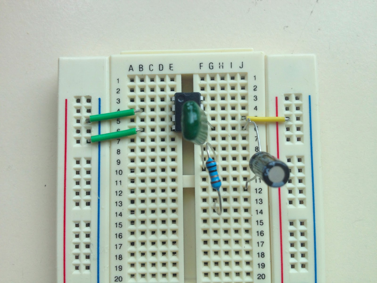 Little Scale Breadboard Basics 2 From Schematic To Capacitors And Resistors A Circuitbreadboard Wires Batteries Connect The 10r Resistor Unused Leg Of Green 47nf Capacitor Other Should Go New Row