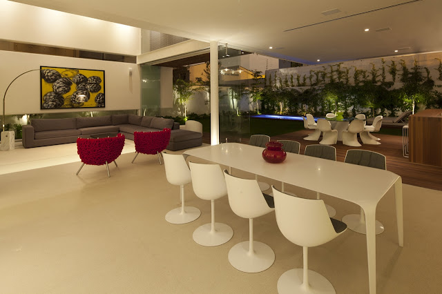 Modern dining room of FF House in Mexico at night