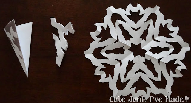 Paper Snowflake Curtain Tutorial - Template 2 folded, cut out and final product
