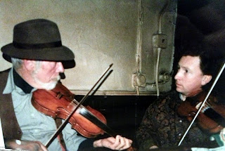 Dan Collins (left) fiddling with Frankie Gavin.