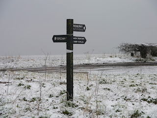 Ridgeway signpost in snow near the Uffington White Horse
