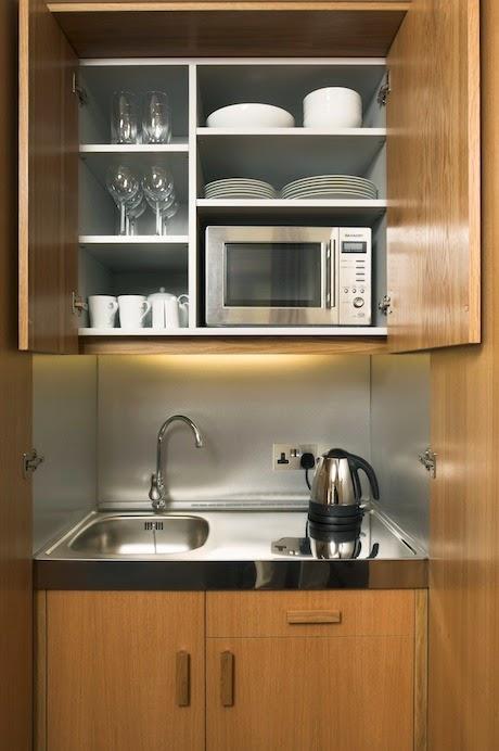 Dise os de cocinas dentro de un armario for Cocinas diferentes