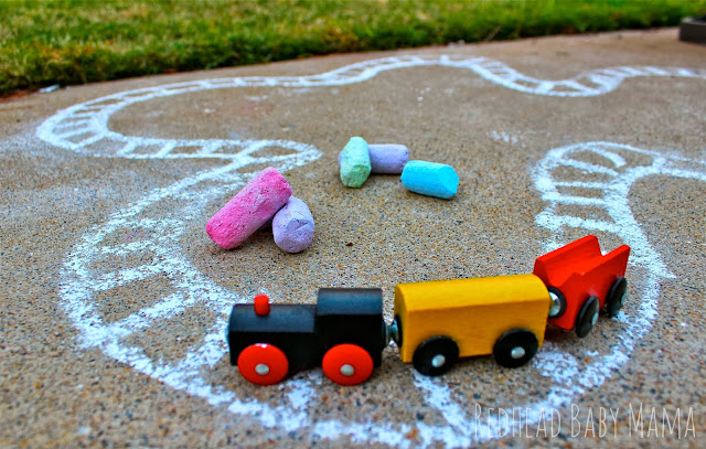Go beyond the rails with a little sidewalk chalk.  Draw a road, a track, a village. Sky's the limit!
