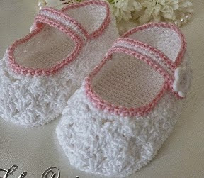 http://www.craftsy.com/pattern/crocheting/clothing/lacy-baby-shoes/20043?SSAID=780943