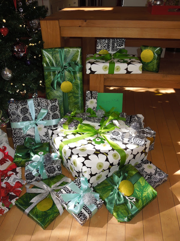 Green, white and black wrapped Christmas gifts