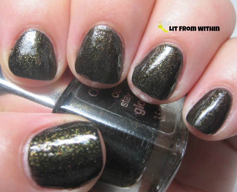 Cover Girl Black Heat, a black polish with flecks of gold and green, and some orange that catch the light.