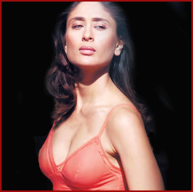 Kareena in a strappy orange top looking down with disdain