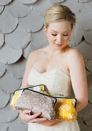 summer bride with an armful of clutches