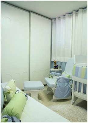 beautiful baby blue bedroom with marine decoration that recreates the