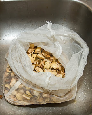 crushed acorn nut meats ready for leaching in a nylon bag