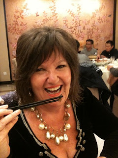 Amanda Brett, Watercolour Artist, pretending to eat scorpions, Beijing Nov 2011