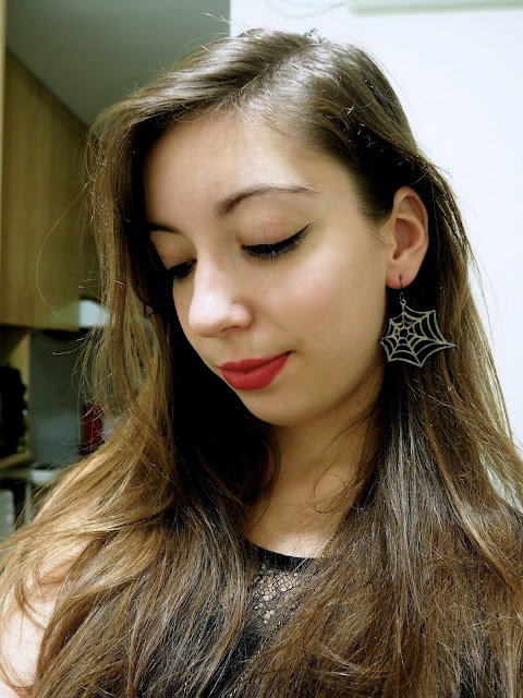 Something Wicked | outfit details of spider web earrings and deep red lipstick