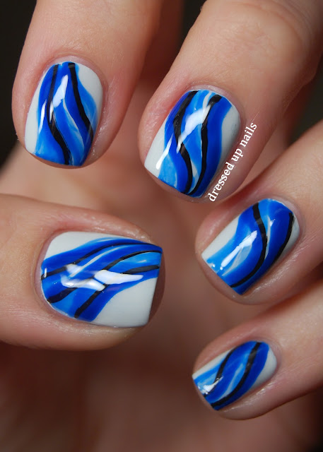 Minimalist abstract water nail art using OPI My Boyfriend Scales Walls and China Glaze Ride the Waves