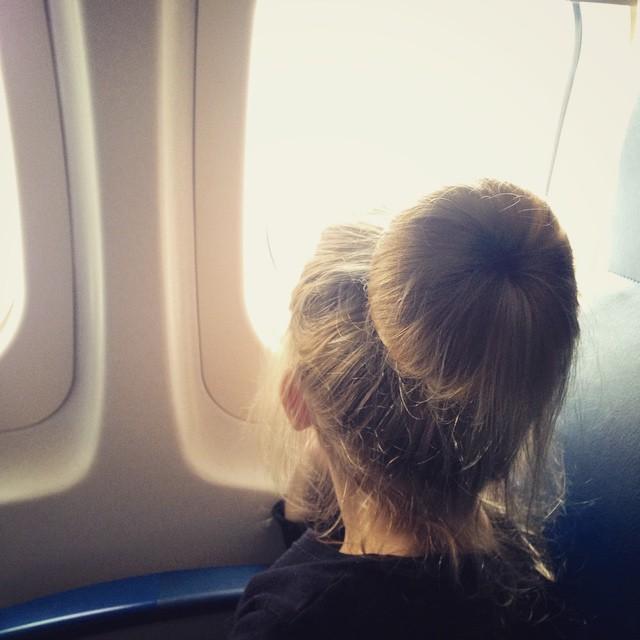 Little kid on an airplane