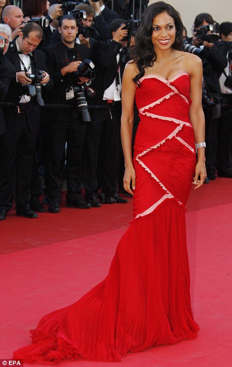 Painting the town red: Rosario Dawson puts on a brave face in Cannes after 'split from boyfriend'