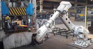 robotik celik dovme presi otomasyonu