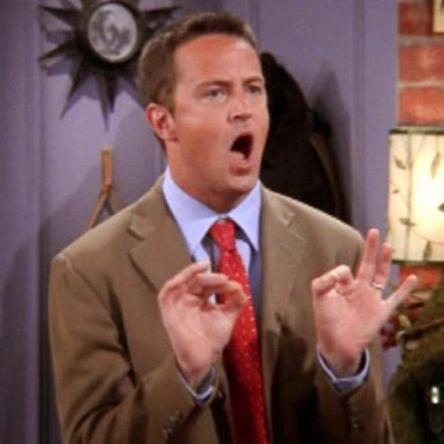 Image of Chandler Bing gesturing with his mouth wide open, looking very serious