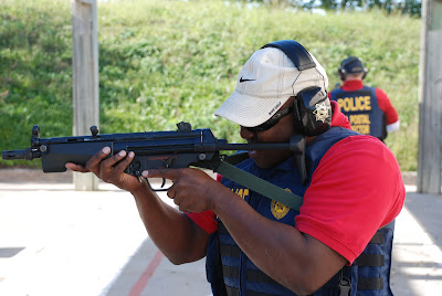 U.S. Postal Inspector Carl King practiced shooting a weapon at the firing range.