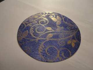 Circle of blue Gelli print with gold mice overlay