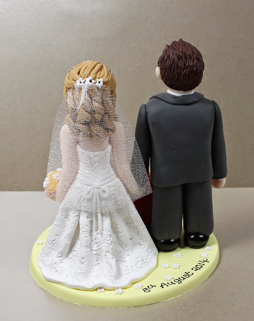 Polymer clay cake topper from behind