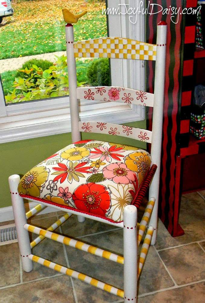 http://joyfuldaisy.com/whisical-hand-painted-furniture-rubber-stamped-chair/