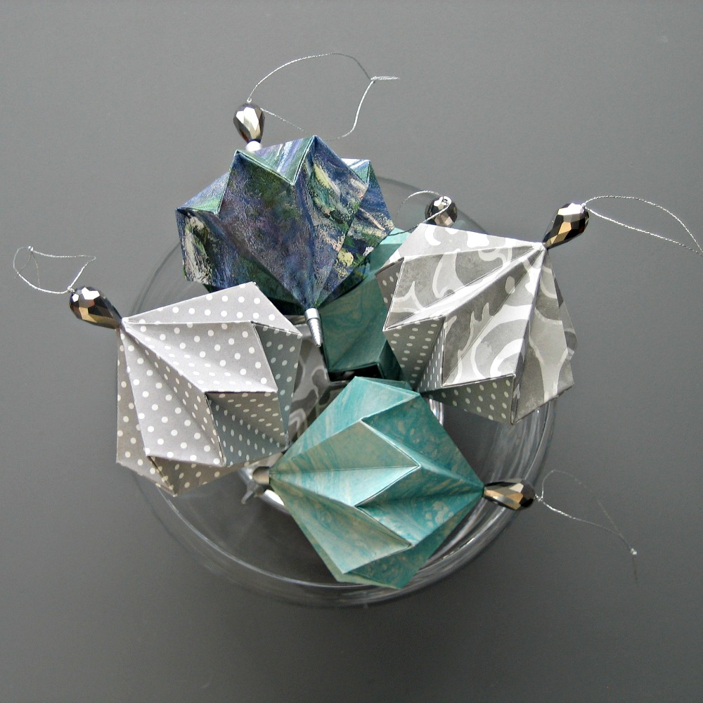 folded paper ornaments These exploding, foldable paper ornaments are just so fun to make once you have it down, they go very quickly and before you know it you have a couple dozen of them.