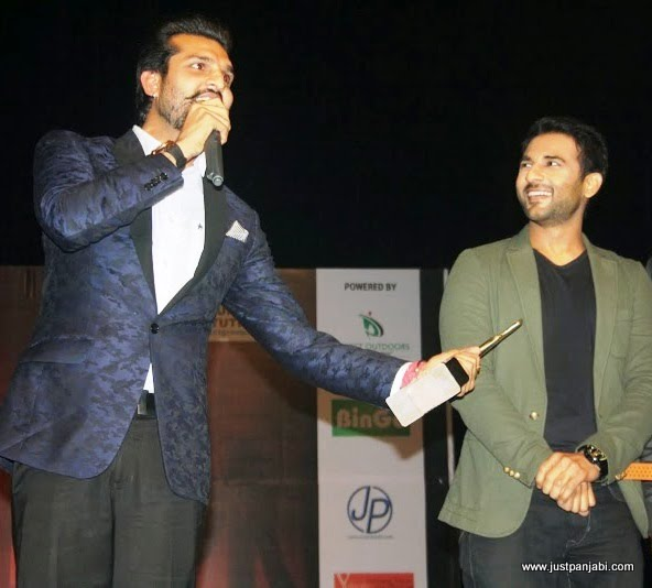 Punjabi Actor Yuvraj Hans and Harish Verma sharing a light moment on Just Panjabi sponsored event PCGH