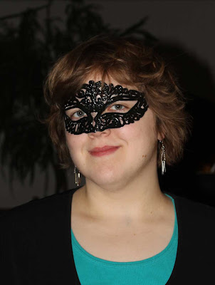 young woman wearing black lacy mask