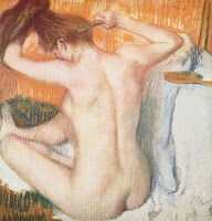 Naked woman on bed brushing her hair in Edgar Degas painting