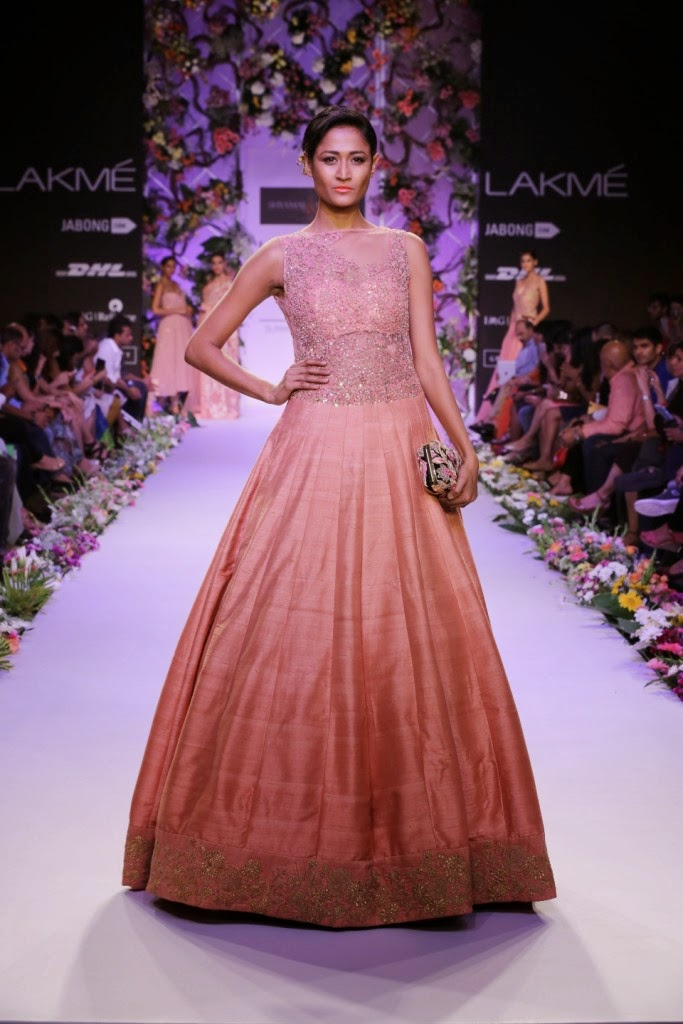 "Aimed at bridal wear for spring/summer, Shyamal and Bhumika presented their collection called ""A Mystical Garden"" which was a floral fantasy at Lakmé Fashion Week Summer/Resort 2014. The Grand Hyatt Ballroom was turned into a fragrant garden with a backdrop of trellised flower bouquets and rows of blossoms that lined either side of the ramp.Inspired by the romantic Edwardian era, there was a marked Gothic influence in the sleeves which were fitted."