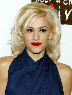 Gwen Stefani Tuck & Roll hairstyle.