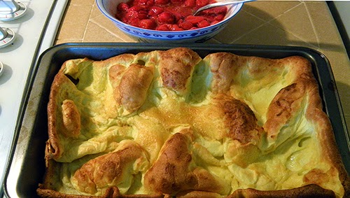Pan of Baked Popover Pancake with Strawberries on Side