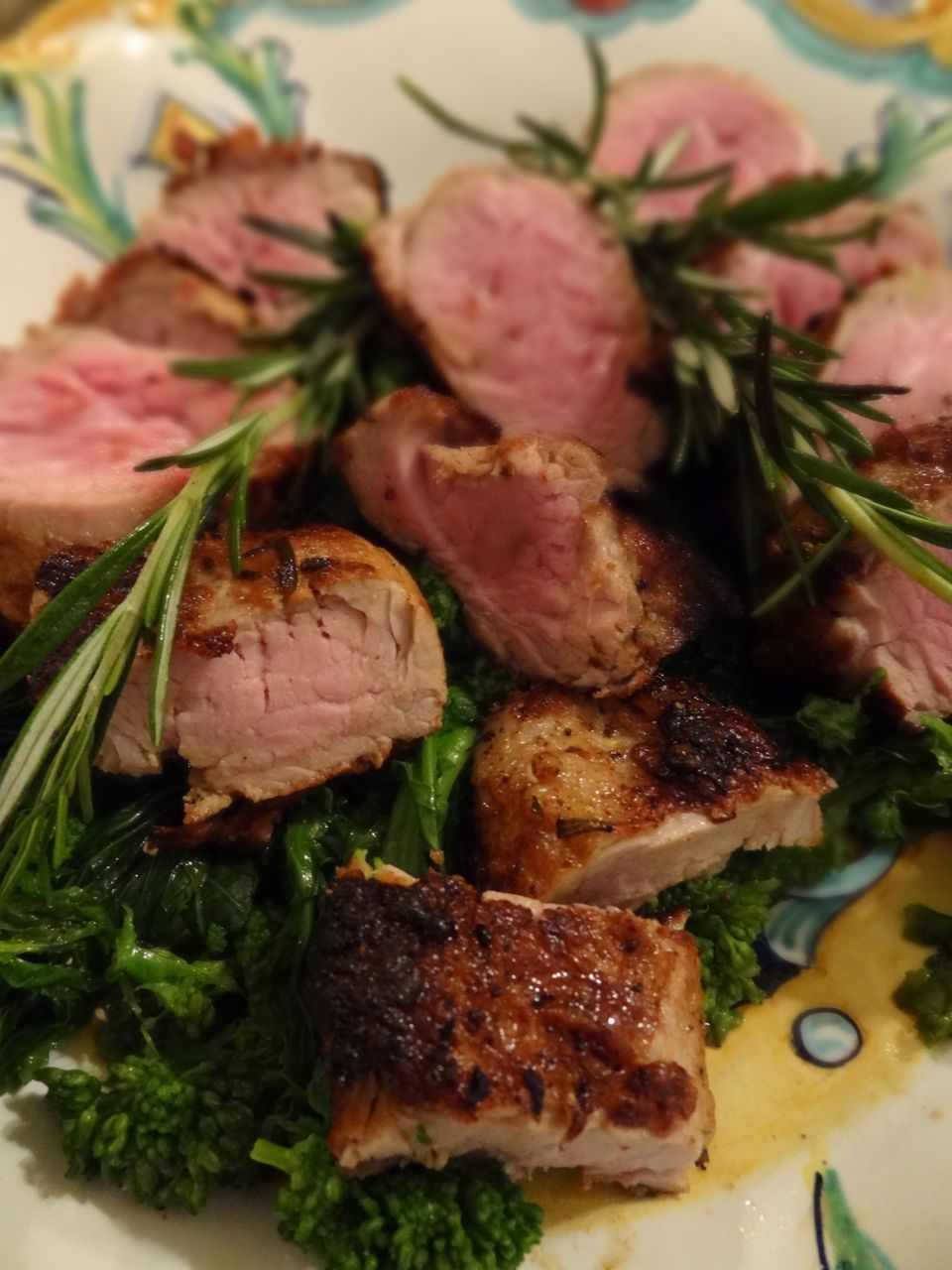 ... Pork Tenderloin served over Steamed Rapini and garnished with rosemary