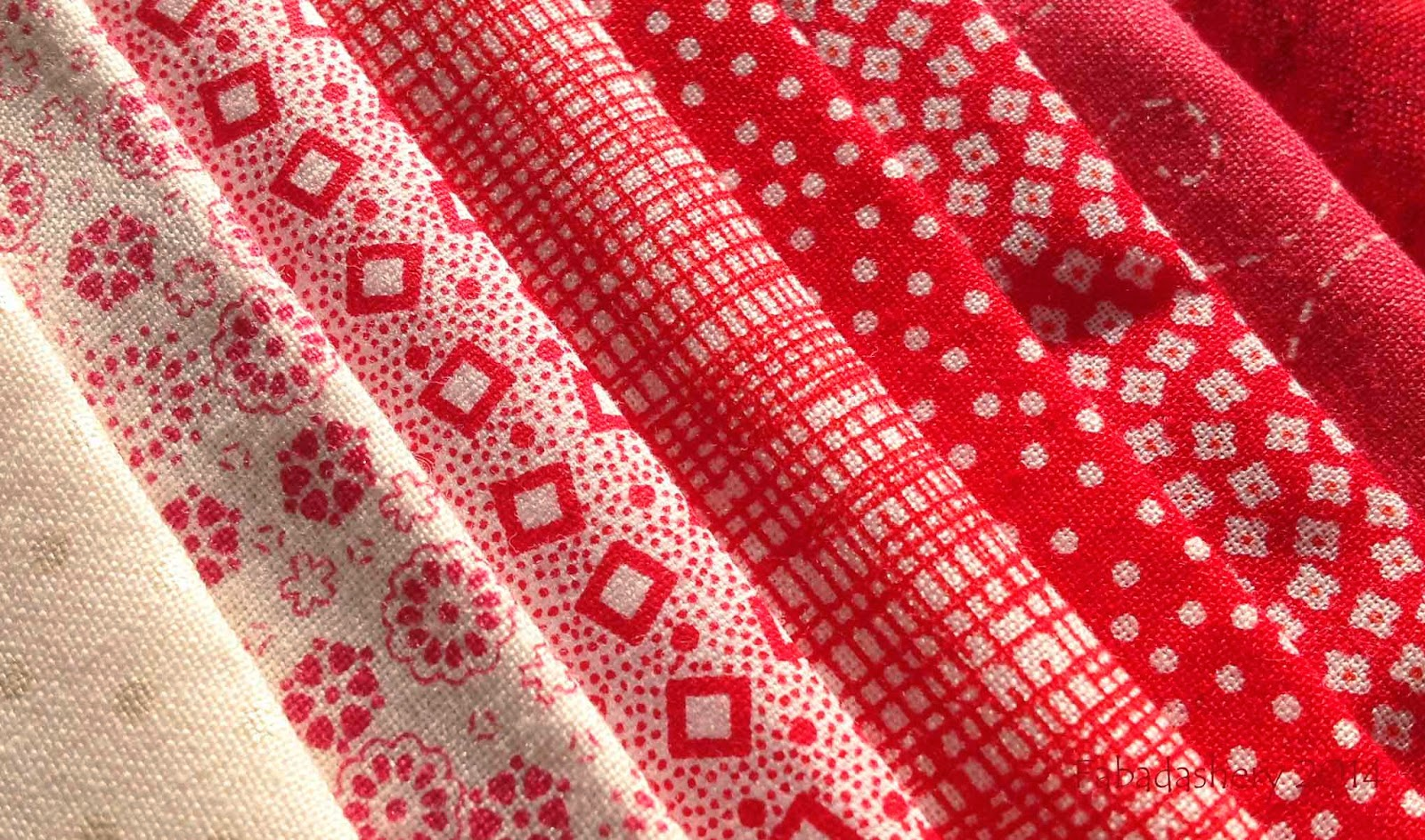 Block 70 - red and white fabrics
