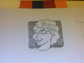 logo for velvet tart costumes and couture: a smirking woman with vintage finger-wave hair giving you a wink.
