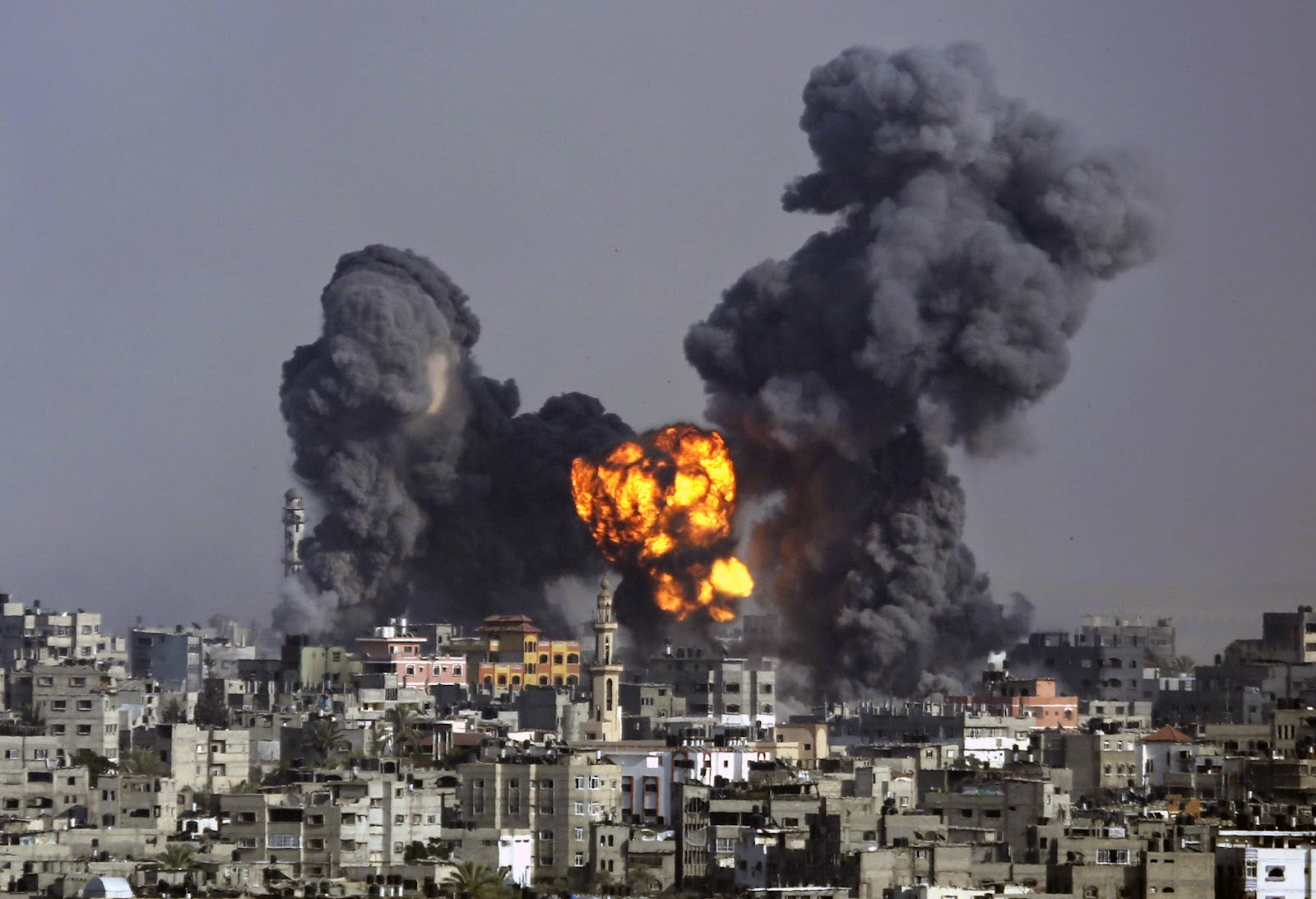 Smoke and fire from the explosion of an Israeli strike rise over Gaza City, Tuesday July 22. Hatem Moussa.