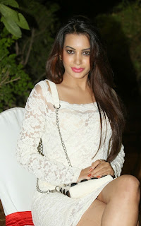 Actress Deeksha Panth Pictures in Short White Lace Dress at Bham Bolenath Audio Launch  39.jpg
