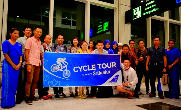 Group of Indonesian tourists on a cycle tour, disembarking at MRIA