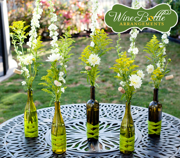 Here is a simply classy wine bottle flower centerpiece for wedding tables