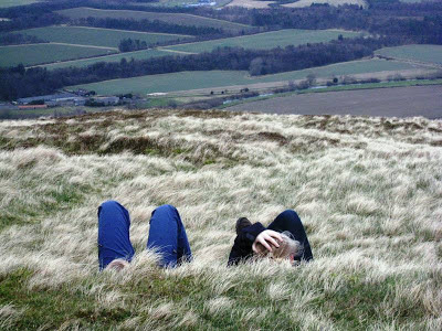 Teenagers lying at the top of the hill