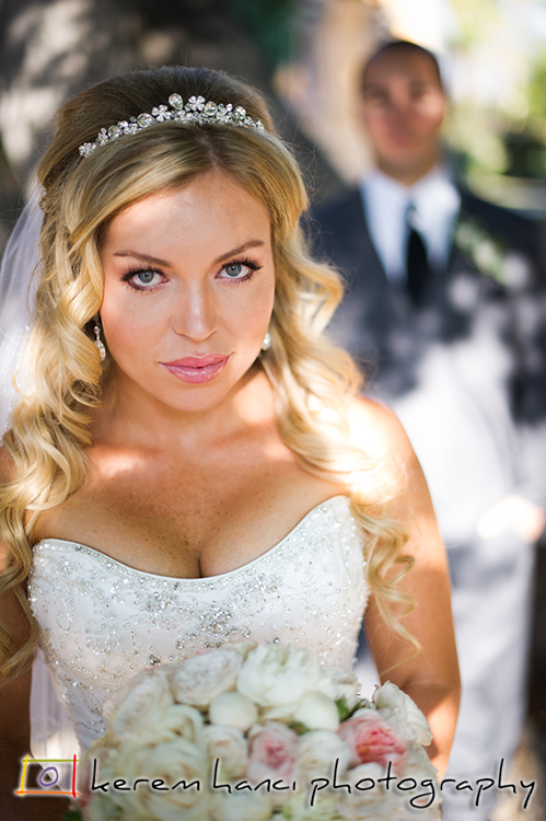 Stunning beauty with piercing eyes shattering the lens while her newlywed husband can't take his eyes off of her.