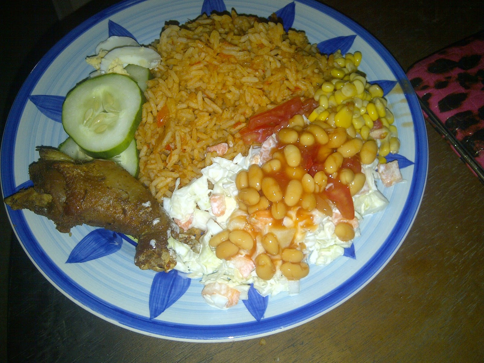 Dobbys signature nigerian food blog i nigerian food recipes i jollof rice and chicken garnished with coleslaw cucumber baked beans sweet corn and boiled egg by cynthia emenife ccuart Choice Image