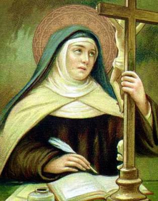 Santa Teresa de Jesus, Escribiendo y con un Crucufijo al Frente