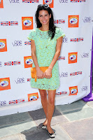 Angie Harmon posing for cameras in a green lace dress