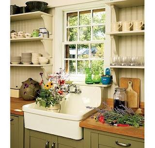 cocina verde fregadero blanco