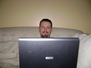 my husband typing on the computer