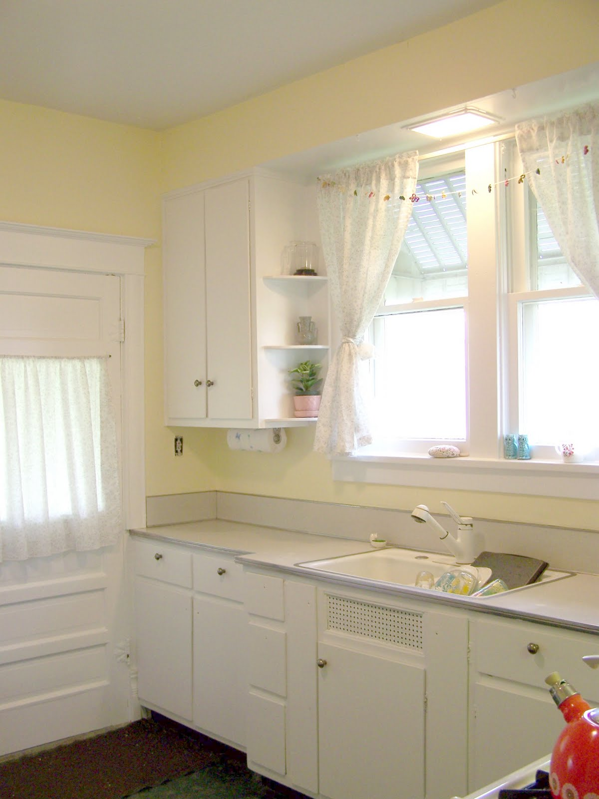 Ponder stitch kitchen before and after photos for Butter cream colored kitchen cabinets