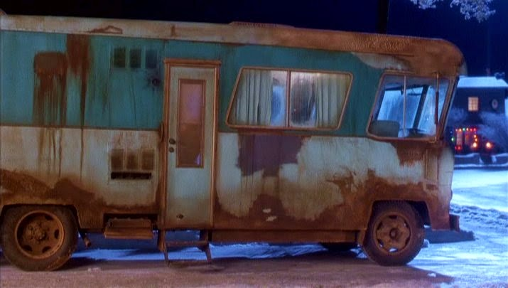 A rundown RV is parked in front of the Griswold's house for Christmas